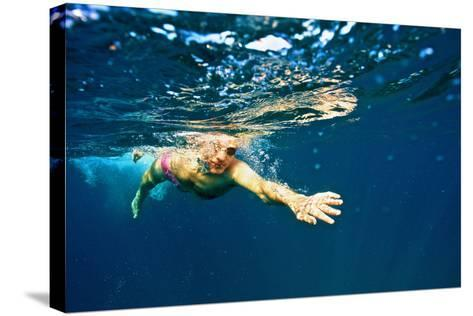 A Man Swims in the Caribbean Sea-Heather Perry-Stretched Canvas Print