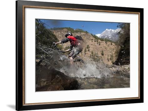 A Mountain Biker Blasts Through a Stream in the Mountains of Nepal-Alex Treadway-Framed Art Print
