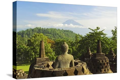Borobodurwith Mount Merapi in the Distance, Kedu Plain, Java, Indonesia-Jochen Schlenker-Stretched Canvas Print