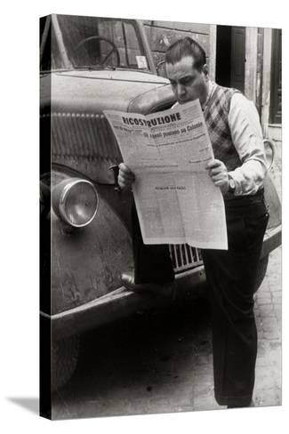 A Man Reads the Newspaper Ricostruzione with the Headline Allies Link Up Cologne-Luigi Leoni-Stretched Canvas Print