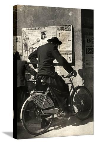 A Priest on a Bicycle Reading Wall Newspapers of the Popular Democratic Front-Luigi Leoni-Stretched Canvas Print