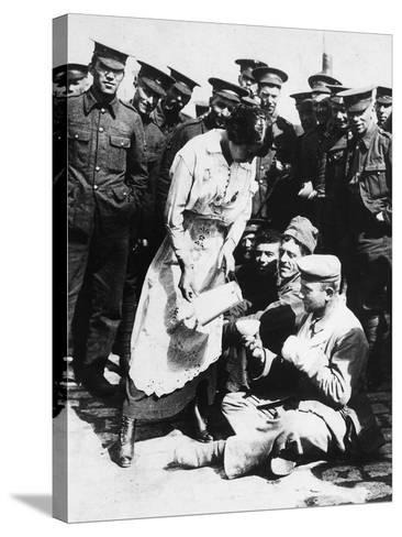 The Images Shows a French Lady Who Assists Some Wounded German Prisoners, Sitting on the Ground--Stretched Canvas Print