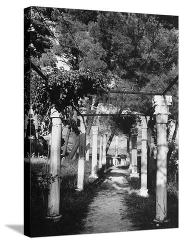 Pergola Held Up by Columns in Salin, Croatia-Dusan Stanimirovitch-Stretched Canvas Print