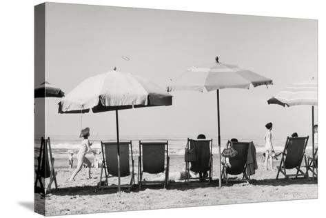 Row of Umbrellas and Chairs-Beach in Viareggio-Renzo Ferrini-Stretched Canvas Print