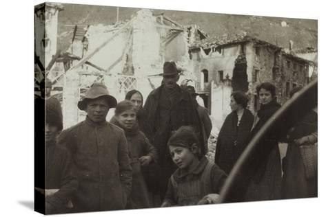 Residents of San Dona Di Piave. in the Background Buildings Destroyed by Bombing in World War I--Stretched Canvas Print