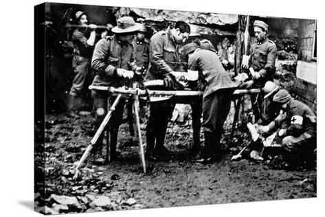 First Aid Given to a Wounded Soldier in the Front Lines During World War I--Stretched Canvas Print