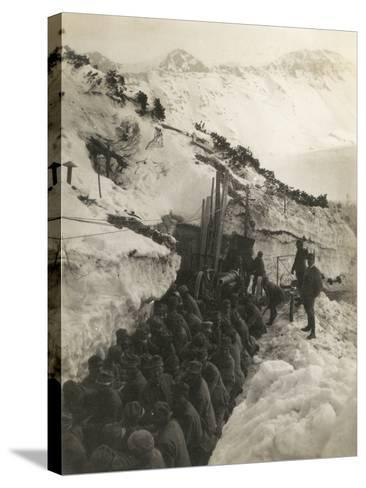 World War I: Soldiers in a Trench in the Snow Pulling a Gun--Stretched Canvas Print