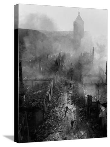 U.S. Infantrymen Move Down a Street in Waldenburg During the 7th Army Advance--Stretched Canvas Print