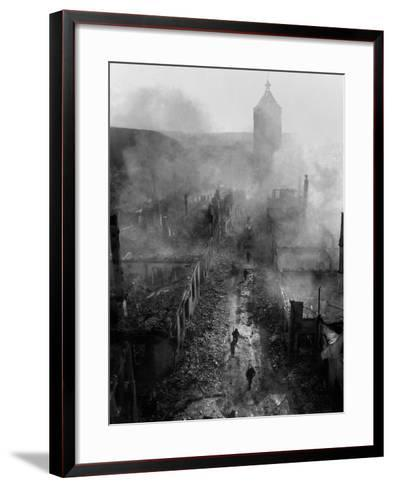 U.S. Infantrymen Move Down a Street in Waldenburg During the 7th Army Advance--Framed Art Print