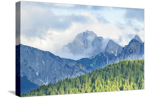 The Mount Sernio Emerges from the Clouds and Stands with Majesty Abiove the Green Woods, Alpi Carni-Gabriele Bano-Stretched Canvas Print