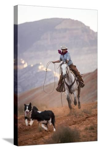 Cowgirl at Full Gallop with Cowdogs Leading Way-Terry Eggers-Stretched Canvas Print