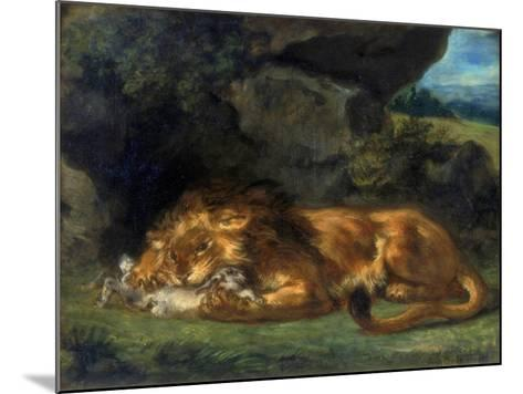 Lion Devouring a Rabbit, 19th Century-Eugene Delacroix-Mounted Giclee Print
