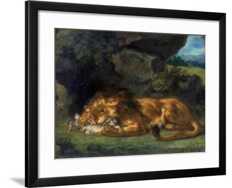 Lion Devouring a Rabbit, 19th Century-Eugene Delacroix-Framed Art Print
