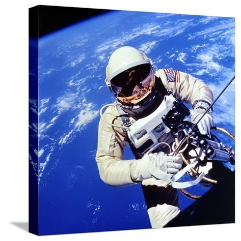 Us Astronaut Edward H. White II Carrying Out External Tasks--Stretched Canvas Print