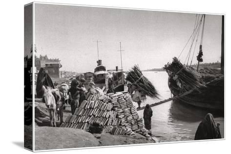 Unloading Cargo from a Boat, Muhaila, Baghdad, Iraq, 1925-A Kerim-Stretched Canvas Print