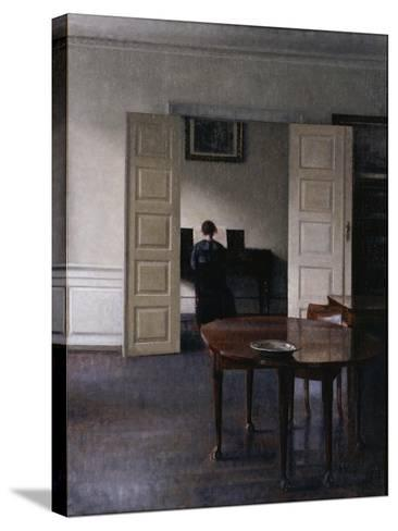 Interior with Ida Playing the Piano-Vilhelm Hammershoi-Stretched Canvas Print