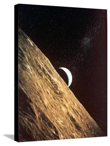 Earthrise Seen from Surface of the Moon, Apollo Mission, 1969--Stretched Canvas Print
