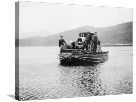An Early Ferry Transporting a Car across a Lake--Stretched Canvas Print