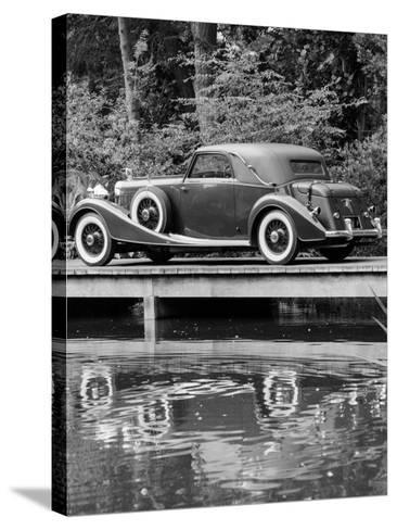 A 1933 Hispano-Suiza K6 Reflected in a Lake--Stretched Canvas Print