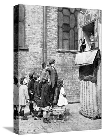 Children Watching a Punch and Judy Show in a London Street, 1936-Donald Mcleish-Stretched Canvas Print