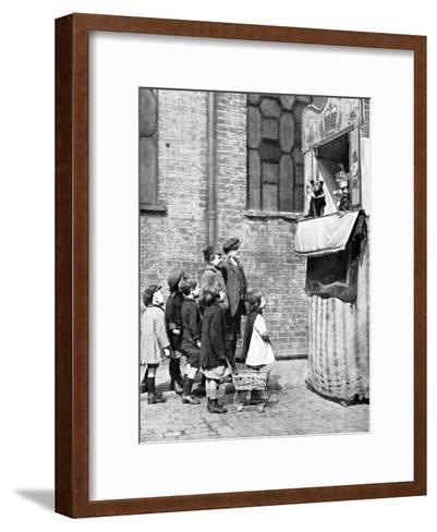 Children Watching a Punch and Judy Show in a London Street, 1936-Donald Mcleish-Framed Art Print