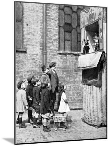 Children Watching a Punch and Judy Show in a London Street, 1936-Donald Mcleish-Mounted Giclee Print
