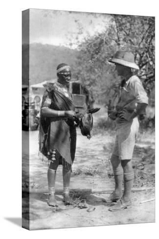 Errol Hinds Making a Deal in Chickens, Wankie to Victoria Falls, Southern Rhodesia, 1925-Thomas A Glover-Stretched Canvas Print