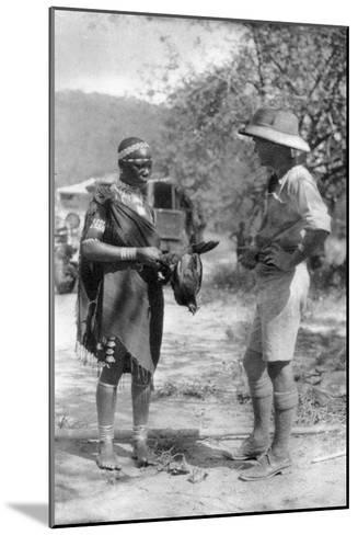 Errol Hinds Making a Deal in Chickens, Wankie to Victoria Falls, Southern Rhodesia, 1925-Thomas A Glover-Mounted Giclee Print