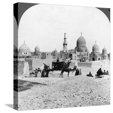 A 'Ship of the Desert' Passing Tombs of By-Gone Moslem Rulers, Cairo, Egypt, 1905-Underwood & Underwood-Stretched Canvas Print
