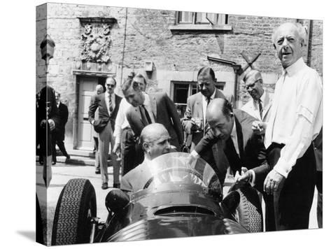 Juan Manuel Fangio at the Wheel of a V16 BRM, 1960s--Stretched Canvas Print