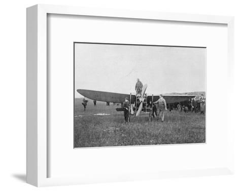 Louis Blériot About to Make the First Successful Flight across the English Channel, 1909--Framed Art Print