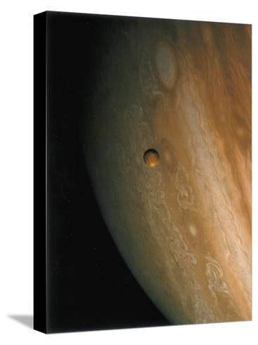 Jupiter and Io, One of its Moons, 1979--Stretched Canvas Print