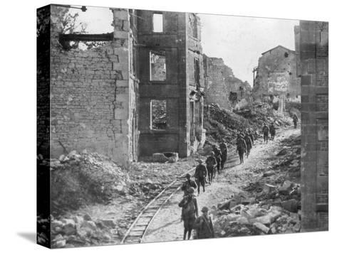 American Soldiers Passing Through the Ruins of Varennes, Meuse-Argonne Offensive, France, 1918--Stretched Canvas Print