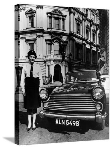 Female Chauffeur Standing by a 1964 Morris Oxford, 1964--Stretched Canvas Print