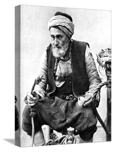 A Peasant Drinking Coffee and Smoking a Huqqah, Izmir, Turkey, 1936--Stretched Canvas Print