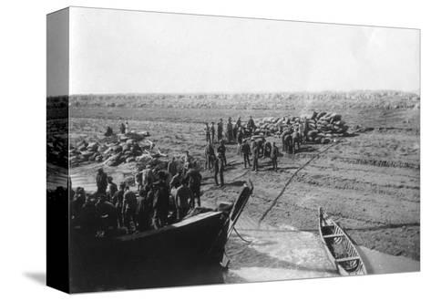 British Troops Unloading Dates on the Shore of the Tigris River, 1918--Stretched Canvas Print