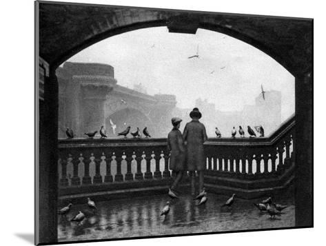 A Man and a Boy Feeding the Birds by Blackfriars Bridge, London, 1926-1927--Mounted Giclee Print