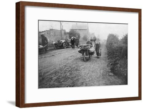 A British Soldier Helping a Woman Return to Her Village, France, 1918--Framed Art Print