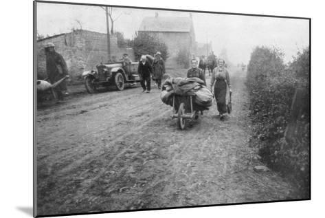 A British Soldier Helping a Woman Return to Her Village, France, 1918--Mounted Giclee Print