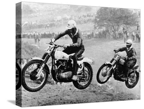 Two Motorcyclists Taking Part in Motocross at Brands Hatch, Kent--Stretched Canvas Print