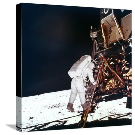 Edwin Buzz Aldrin Descends the Steps of the Lunar Module Ladder to Walk on the Moon, 1969--Stretched Canvas Print