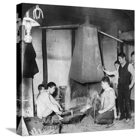 A Japanese Blacksmith at His Forge, Yokohama, Japan, 1904-Underwood & Underwood-Stretched Canvas Print