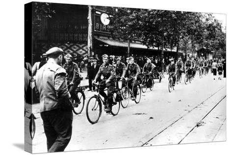 German Soldier Cycling Through the Streets of Paris, June 1940--Stretched Canvas Print