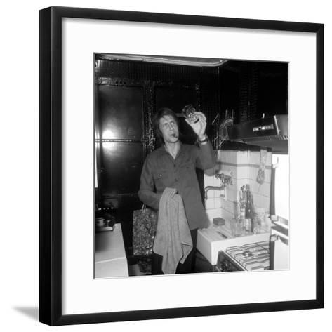 Jacques Dutronc Washing a Glass and Smoking a Cigar in 1972-Marcel Roldes-Framed Art Print