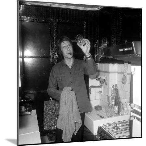 Jacques Dutronc Washing a Glass and Smoking a Cigar in 1972-Marcel Roldes-Mounted Photographic Print