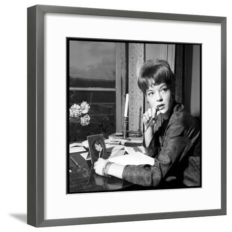 Romy Schneider, Thougthful, Trying to Write a Letter in Front of Alain Delon's Picture-Marcel Begoin-Framed Art Print