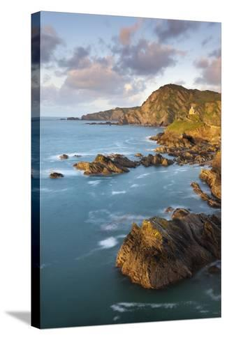 St Nicholas Chapel and Beacon Point on the Rocky Coast of Ilfracombe, Devon, England. Spring-Adam Burton-Stretched Canvas Print