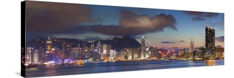 View of Hong Kong Island and Tsim Sha Tsui Skylines at Sunset, Hong Kong-Ian Trower-Stretched Canvas Print