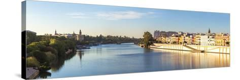 Spain, Andalusia, Seville. Triana District at Sunrise with Guadalquivir River-Matteo Colombo-Stretched Canvas Print