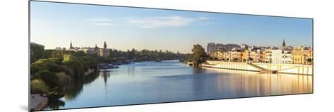 Spain, Andalusia, Seville. Triana District at Sunrise with Guadalquivir River-Matteo Colombo-Mounted Photographic Print